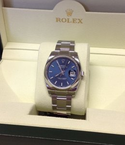 Rolex Oyster Perpetual Date 34mm 115200 Blue Baton Dial Brand New Unworn 2015
