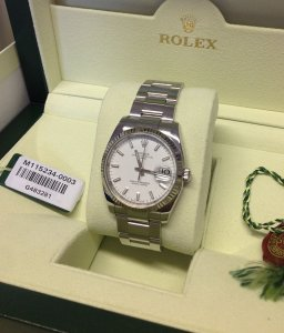 Rolex Oyster Perpetual Date 34mm White baton Dial Fluted Bezel 115234