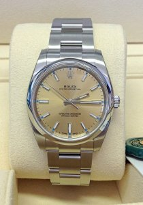 Rolex Oyster Perpetual 114200 34mm Champagne Dial