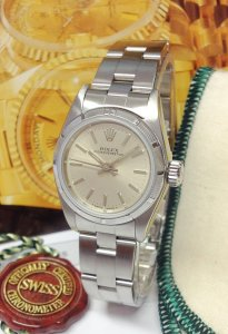 Rolex Oyster Perpetual 67230 26mm Silver Dial